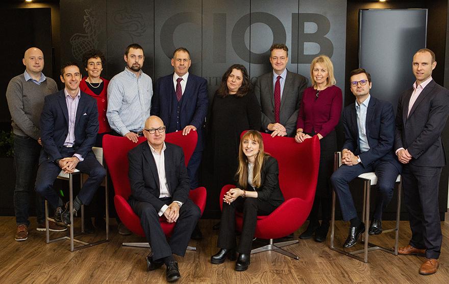 Group shot of debate participants with Julian Kent